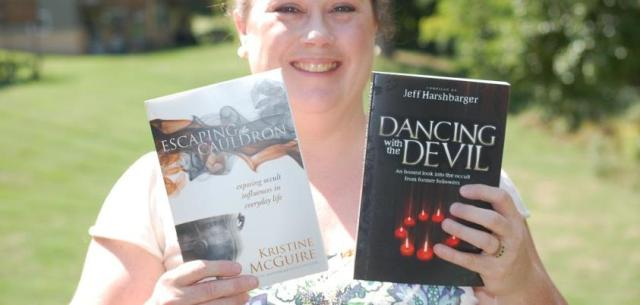 My friend Kristine McGuire holding copies of her own book & also Jeff Harshbarger's book, which she, Vince McCann & I have also contributed chapters in.