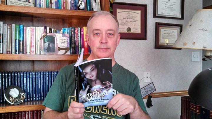 Jeff Harshbarger reading Laura's book.