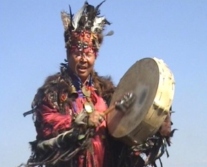shaman using a drum to summon spirits