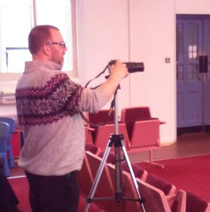 Roger Kenyon filming the event