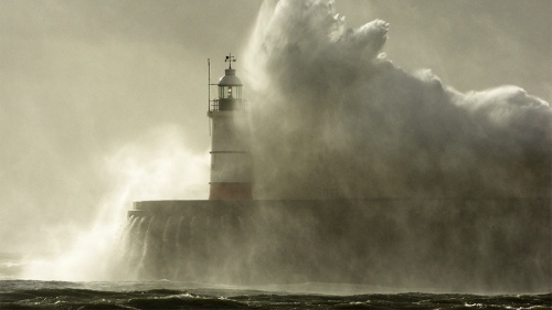 lighthouse in storm tsunami